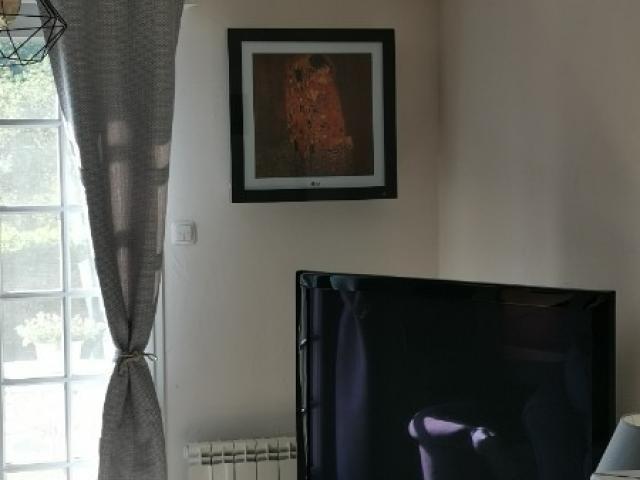 Installation d'une climatisation avec panel photo dans véranda et salon